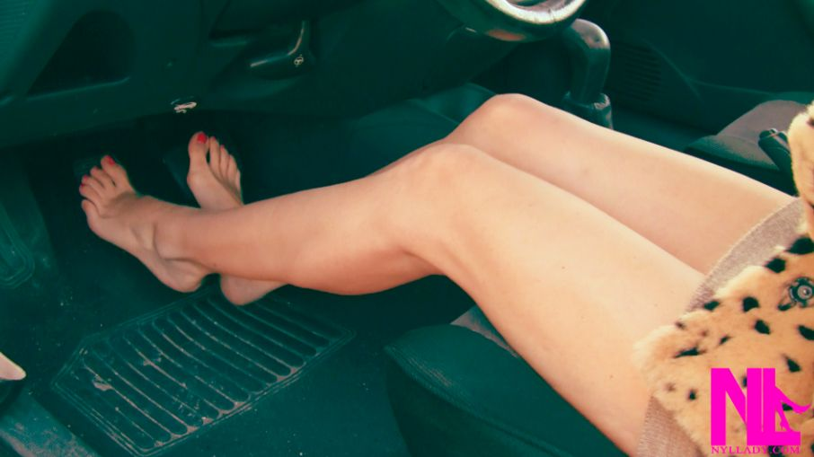 Pedal pumping and driving in black pumps on barefoot