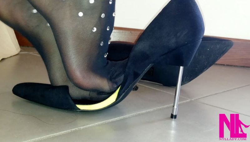 Sensual dangling and seducing in black Wolford pantyhose and black pumps with metal heels